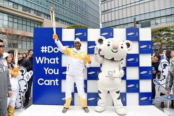 Seun Adebiyi And Mascot